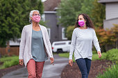 istock Two women wearing protective face masks enjoying the outdoors during Coronavirus 1256012768