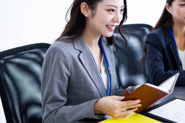 two women who is working in ther office stock photo