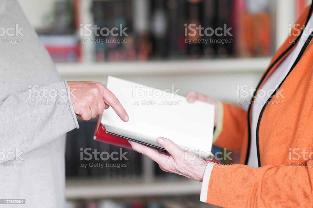 Two women with book stock photo