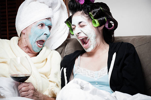 two women with drying beauty face masks - kellyjhall stock pictures, royalty-free photos & images
