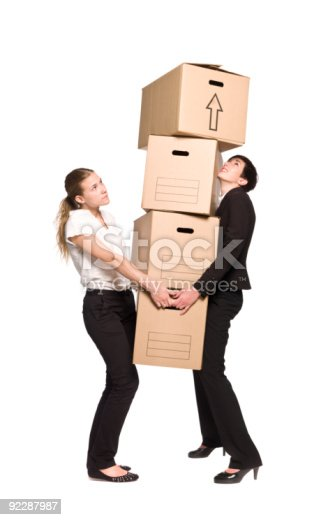 istock Two women with four boxes 92287987