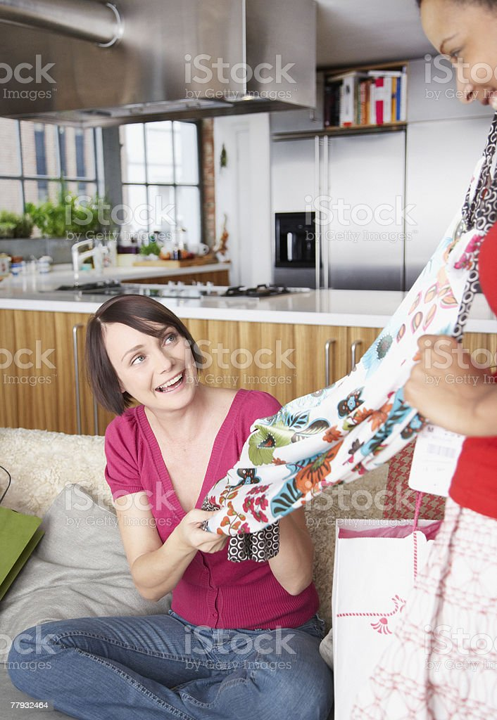 Two women with shopping bags in living room royalty-free stock photo