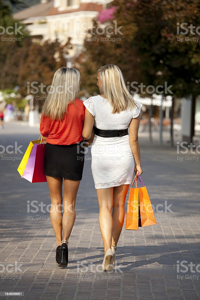 Two women with shopping bags royalty-free stock photo