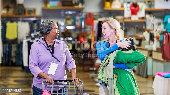1166905017 istock photo Two women working in clothing store 1128244869