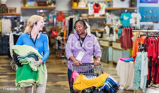 1166905017 istock photo Two women working in clothing store 1140890875