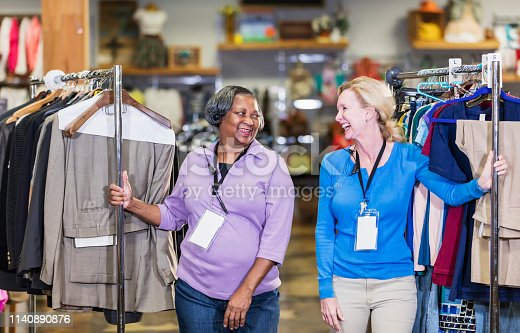1166905017 istock photo Two women working in clothing store 1140890876