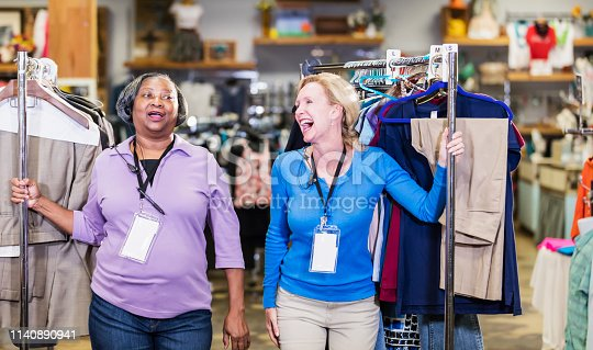 1166905017 istock photo Two women working in clothing store 1140890941
