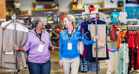 1166905017 istock photo Two women working in clothing store 1140890954