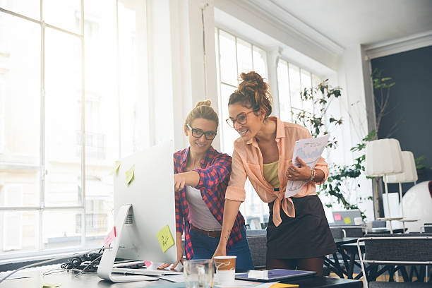 Two women working together in office – Foto