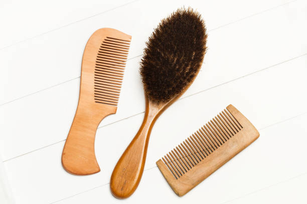 Two wooden combs Two wooden combs and a hairbrush hairbrush stock pictures, royalty-free photos & images