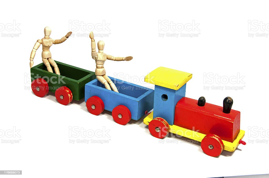 two wooden dolls sitting on a train royalty-free stock photo