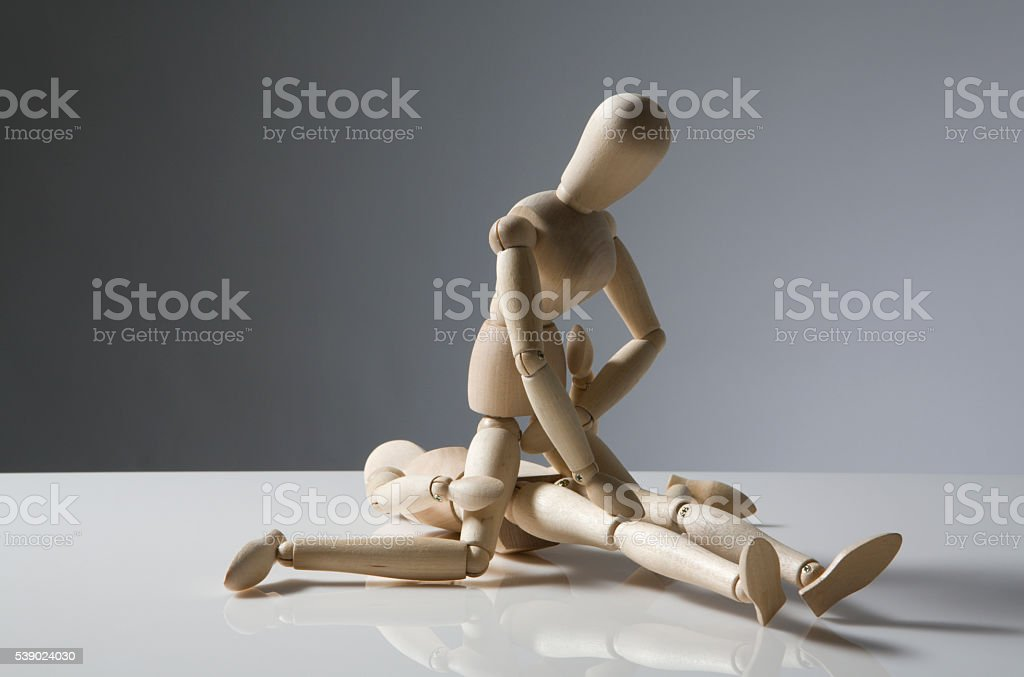 two wooden figures stock photo