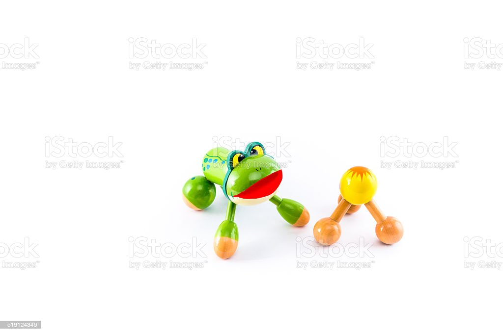 Two wooden massage devices, frog and yellow knob. royalty-free stock photo