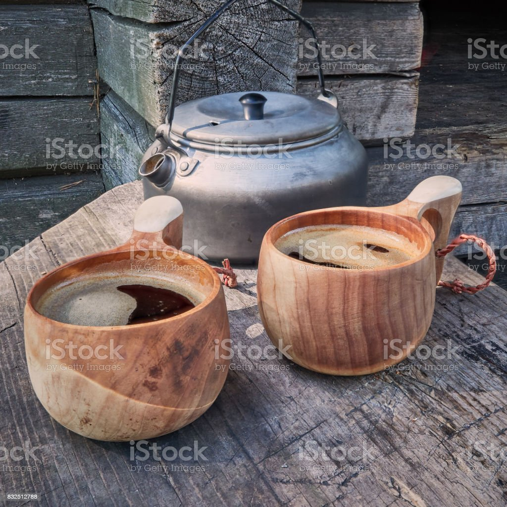Two wooden mugs filled with coffee stock photo