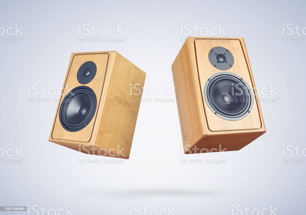 Two wooden speakers on light blue background. File contains a path to isolation. stock photo