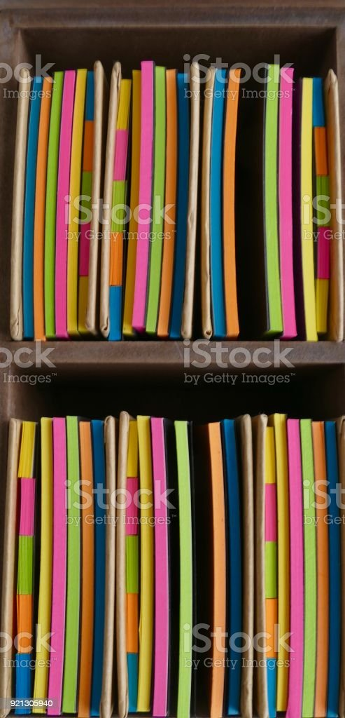 Two wooden stationery boxes and colorful adhesives notes stock photo