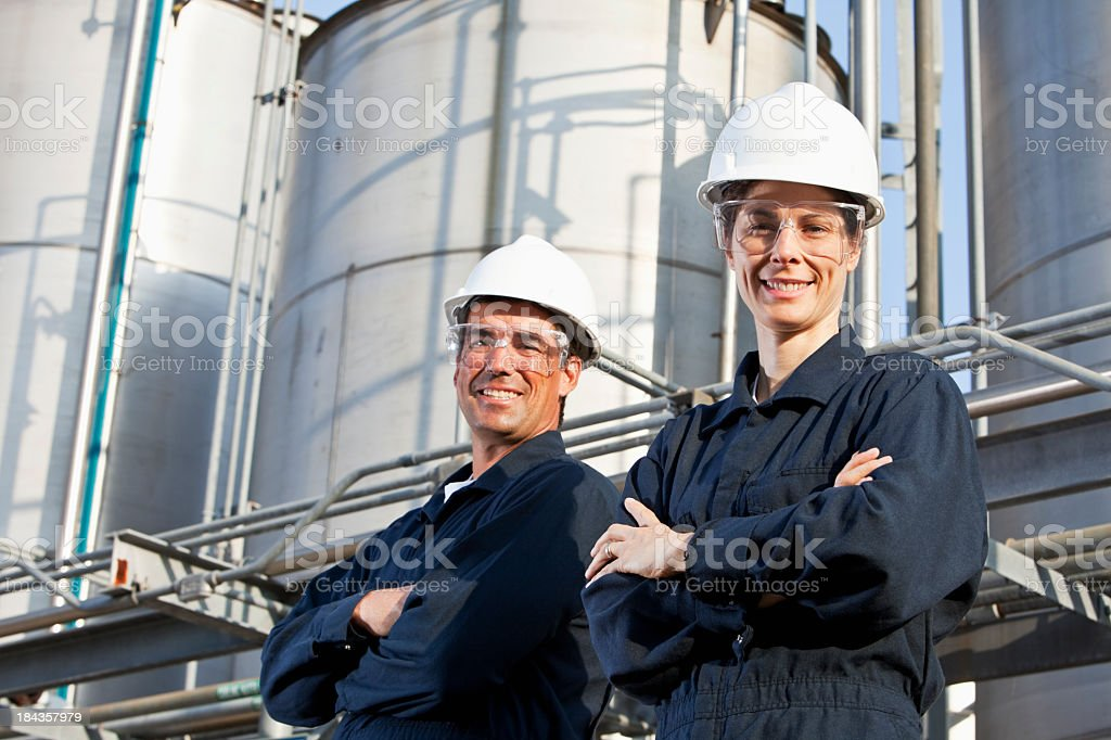 Two workers at industrial plant stock photo
