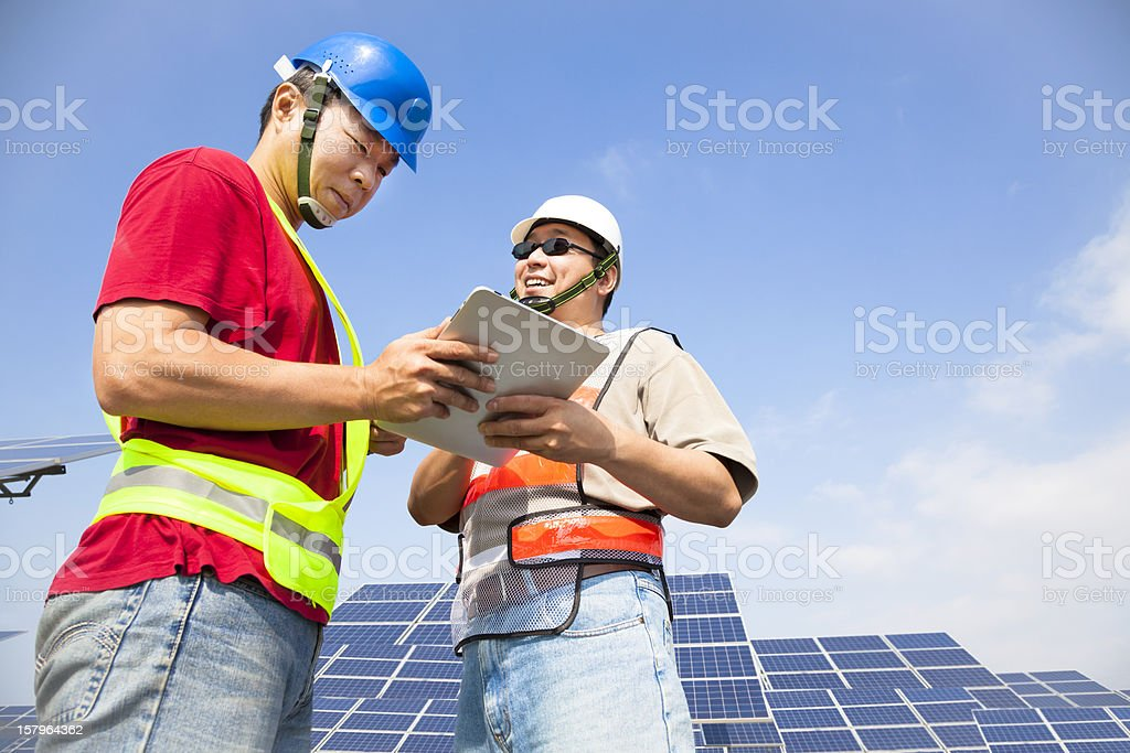 two workers  discussing with tablet pc stock photo