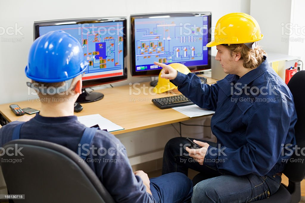 Two Workers in a Control room stock photo