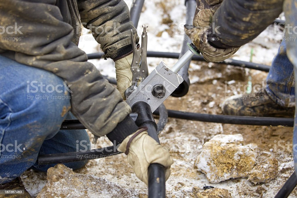 Two Workers Join Residential Geothermal Heating/Cooling Pipe​​​ foto