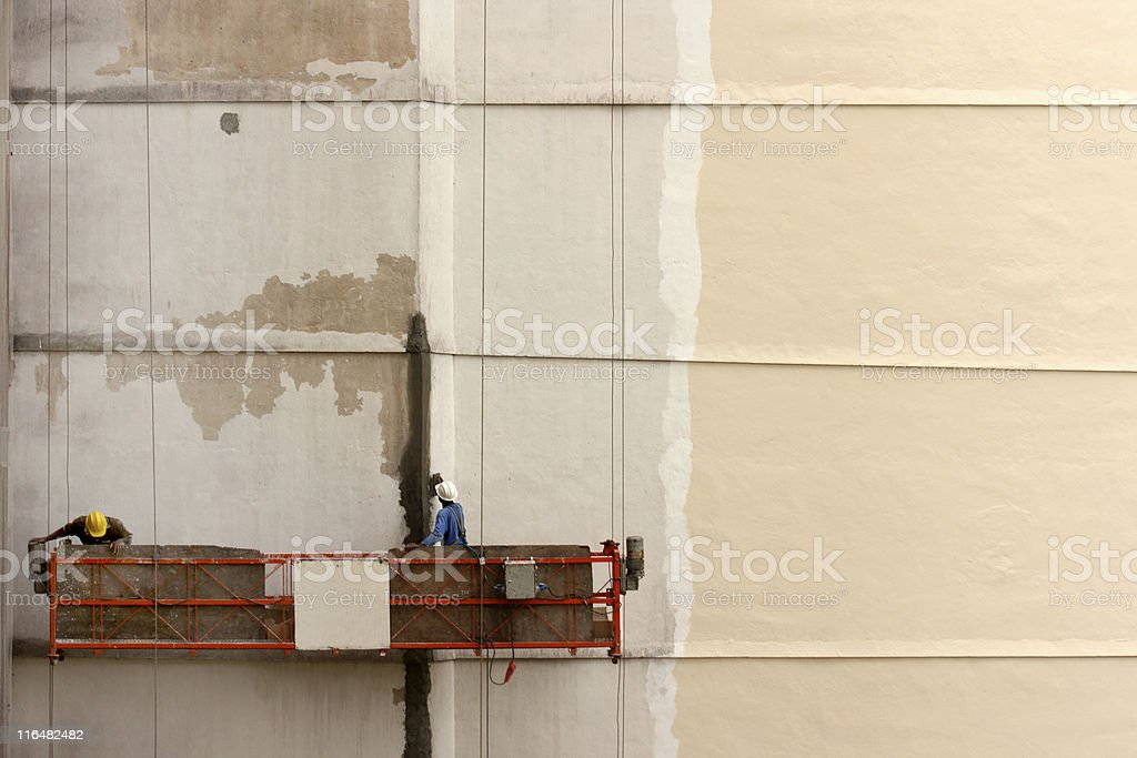 Two workers on a scaffold royalty-free stock photo