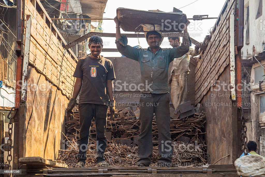 Two workers on truck stock photo