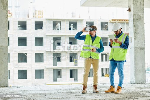 534196421istockphoto Two Workers Using VR on Site 1035457556