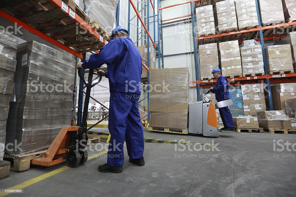 Two workers working in storehouse royalty-free stock photo