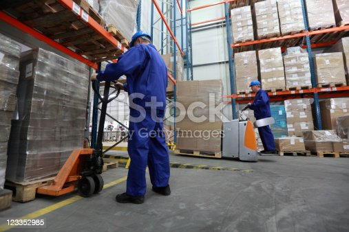 istock Two workers working in storehouse 123352985