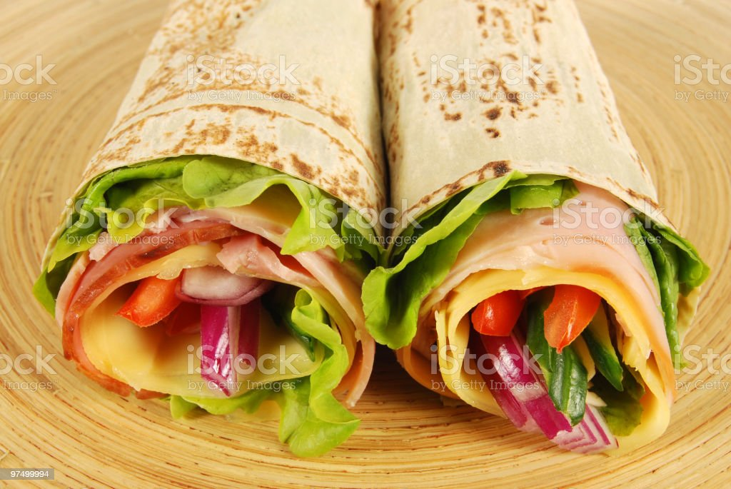 Two wrap sandwiches on wooden tray royalty-free stock photo