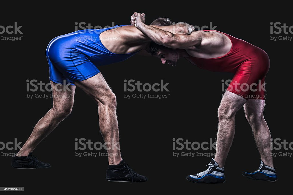 Two wrestlers holding each other in clutch isolated stock photo