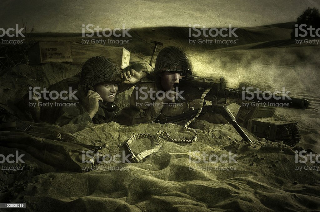 Two WWII Soldiers Under Attack In Their Foxhole stock photo