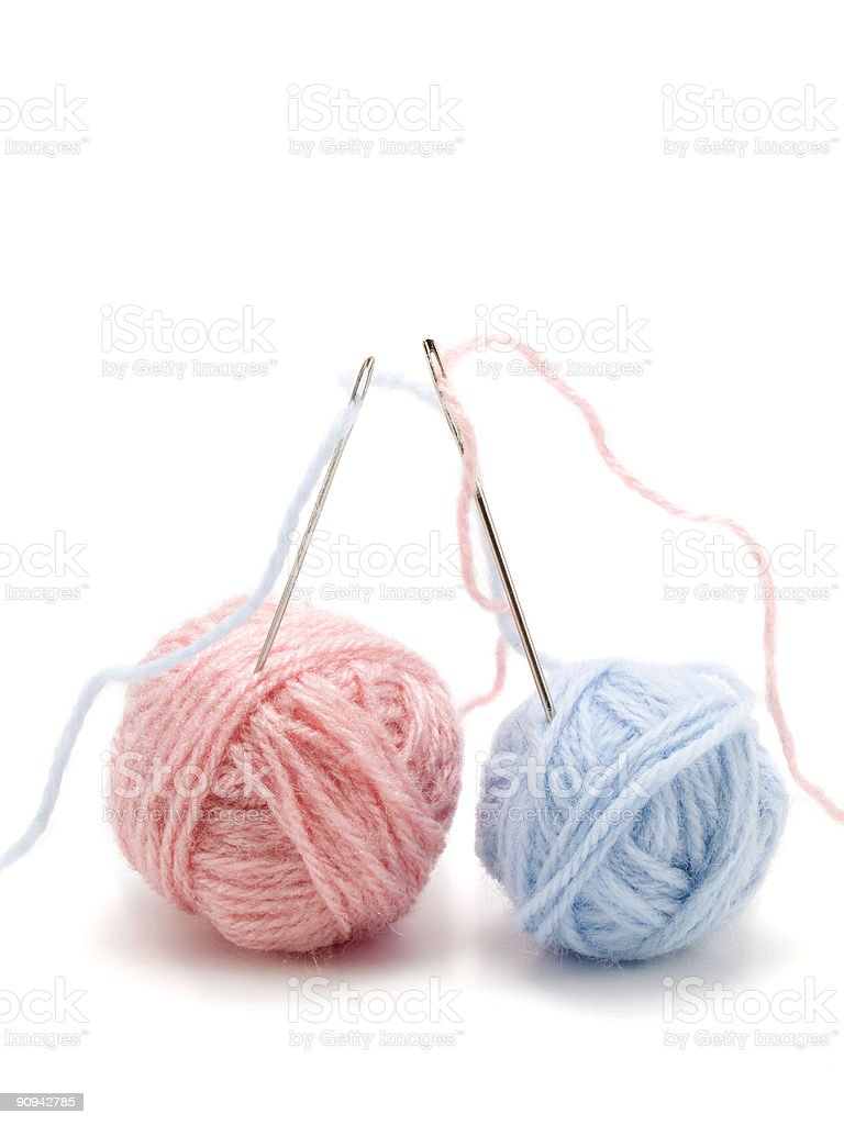 Two yarn balls with needles royalty-free stock photo