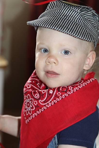 two year old at his birthday - festzugskleidung stock-fotos und bilder
