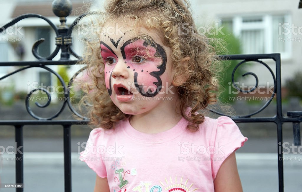 Two year old girl face painting portrait royalty-free stock photo