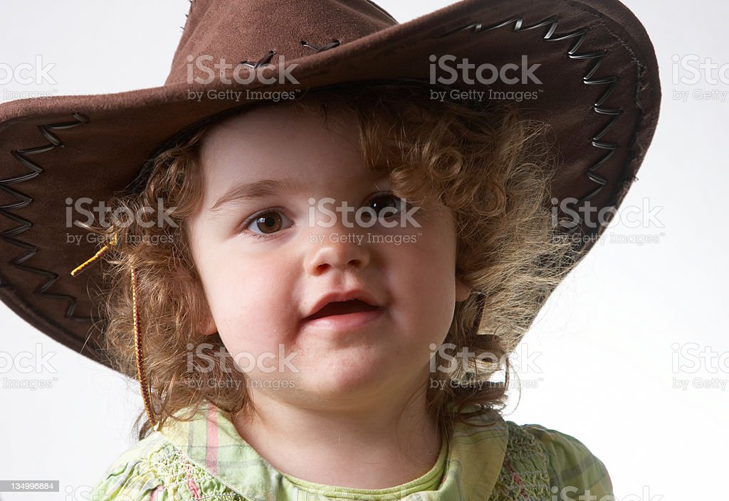 Two year old girl portrait wearing cowboy hat royalty-free stock photo 19da25bc52e