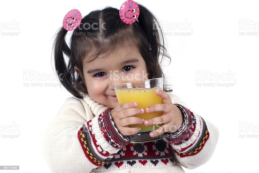 two years old girl is drinking orange juice royalty-free stock photo