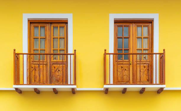 Two Yellow Balconies, Cuenca, Ecuador stock photo