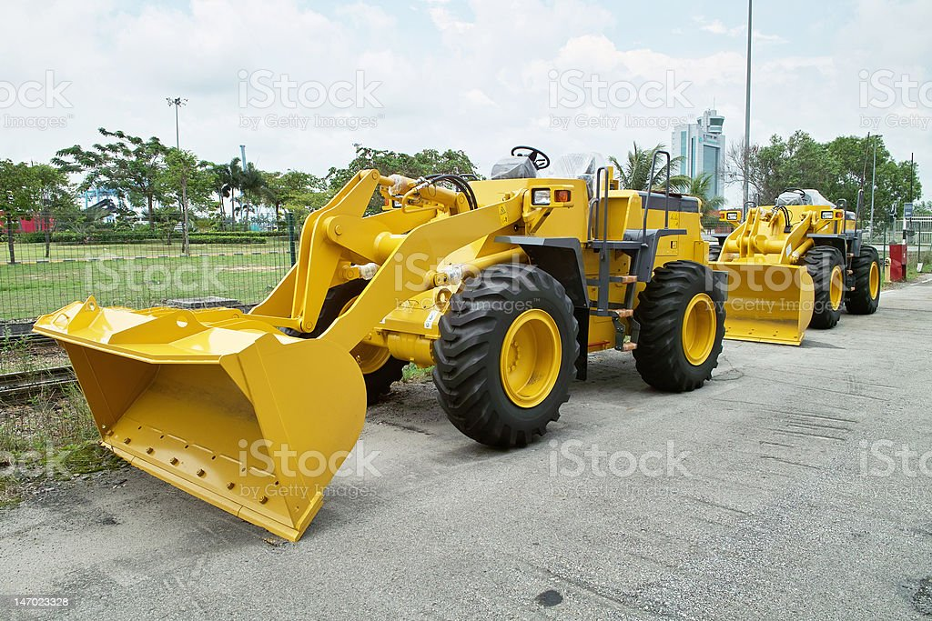 Two Yellow Bulldozers at Roadside royalty-free stock photo