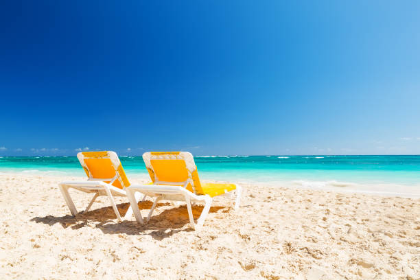 Two yellow chairs on a beautiful caribbean beach picture id923793254?b=1&k=6&m=923793254&s=612x612&w=0&h=qgb7ct49ketgxow1mqq yf wgcyvk5pr2owpirveo7k=