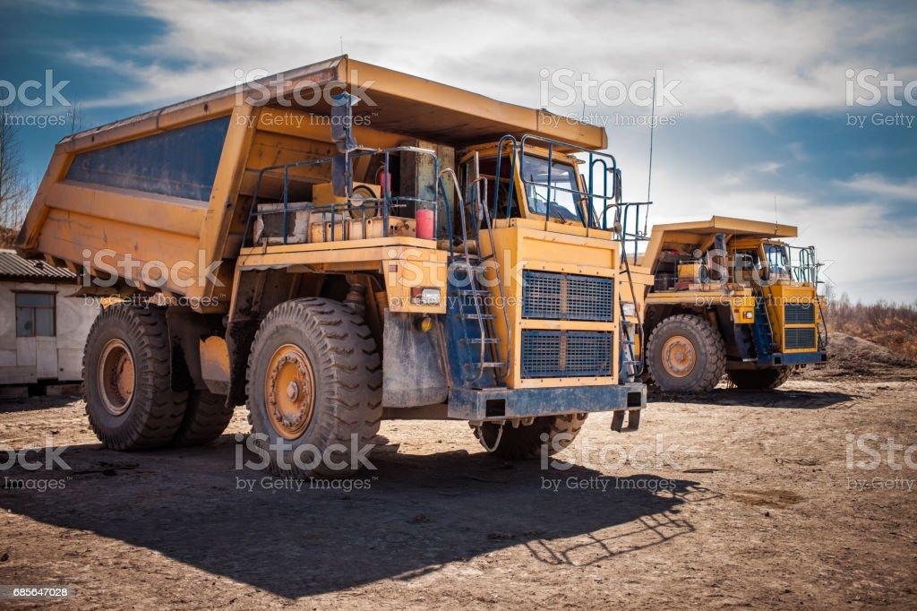 Two yellow dump trucks royalty-free 스톡 사진