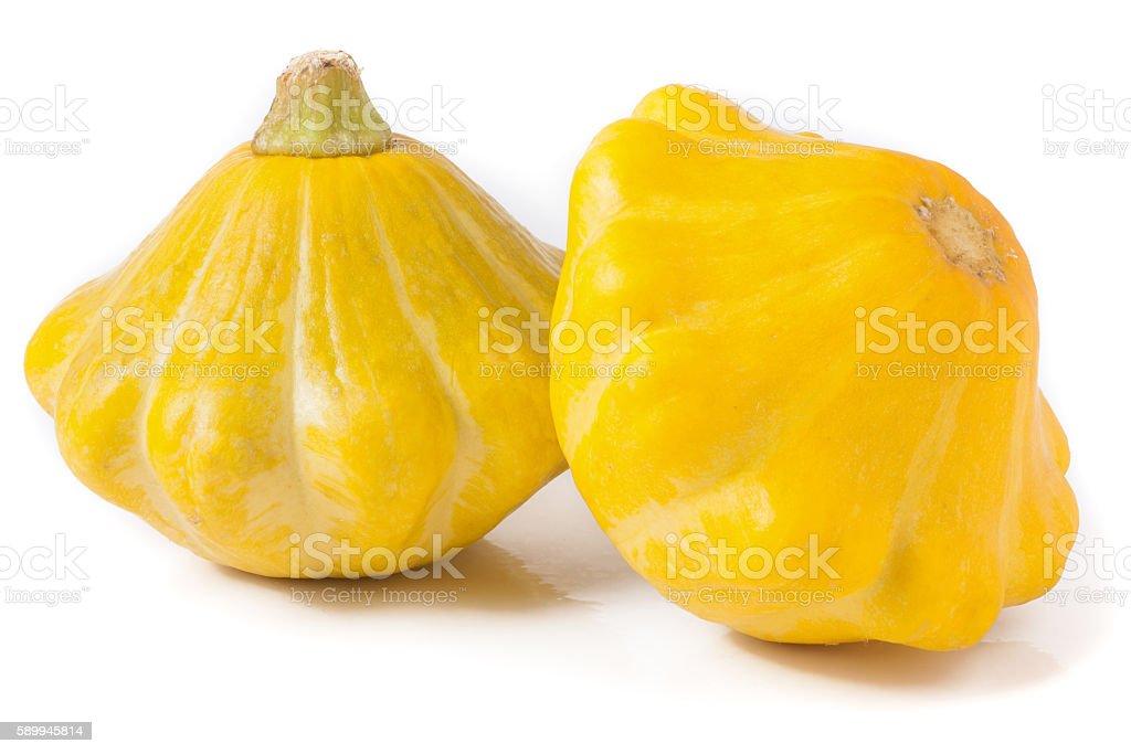 two yellow pattypan squash isolated on white background stock photo