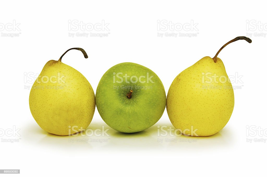 Two yellow pears and green apple isolated on white royalty free stockfoto