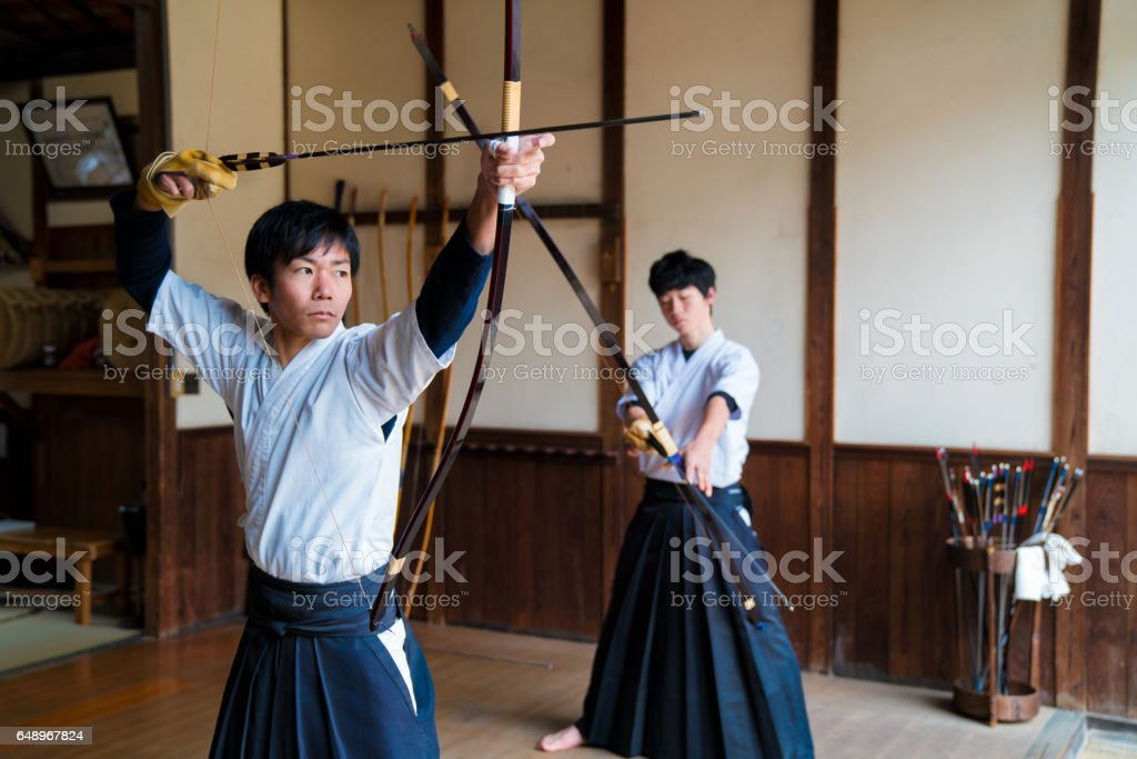 Two young adult archers stock photo
