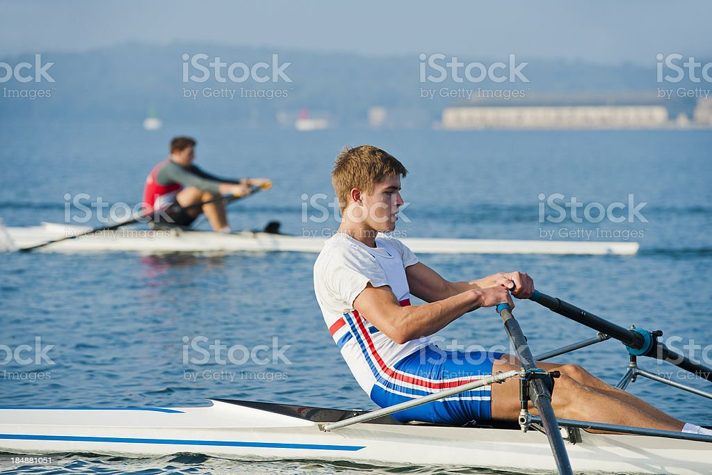 Two young adult rowing men during the race stock photo