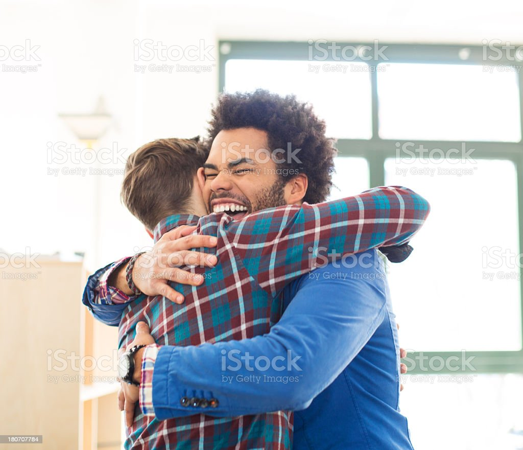 Two young adults celebrating stock photo