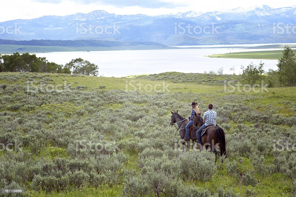 Two Young Adults on Horseback In Montana stock photo