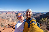 Couple taking selfie picture on top of Grand Canyon USA