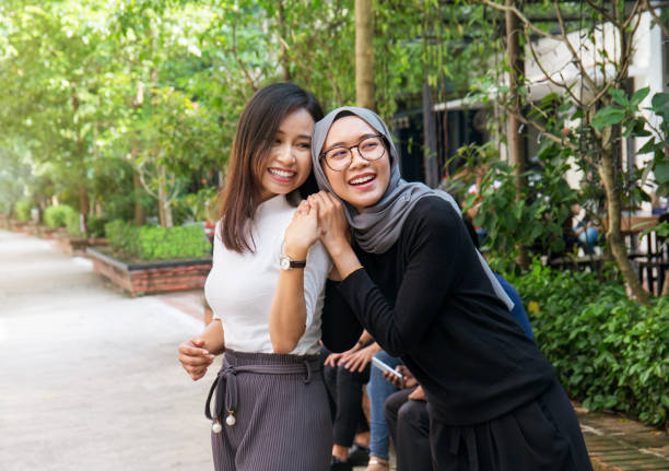 Two young Asian girls having fun outdoors Two young Asian girls having fun outdoors indonesian ethnicity stock pictures, royalty-free photos & images