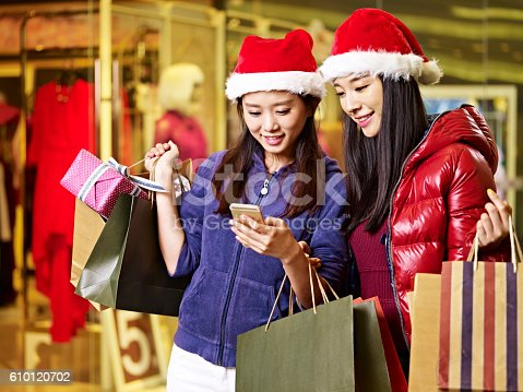 istock two young asian women shopping for christmas 610120702